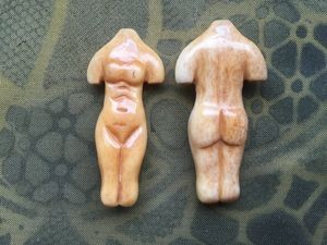 Bone:  Hand-carved bone female body bead