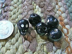 Ceramic:  Smaller black skull beads with horizontal hole