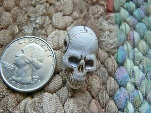 High fired large elongated porcelain ceramic skull bead