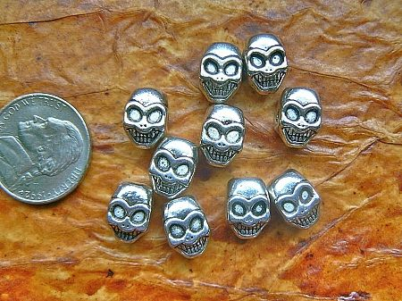 Lead free pewter grinning angular skull beads (10)