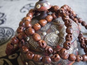 108 bead wood skull bead mala 15x16mm