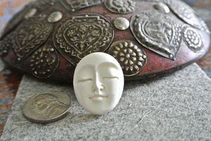 Bone:  Carved Indonesian Oval Face Cabochon Beads
