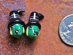 Two Green and Black Lampwork Witch Head Beads