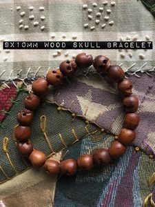 Wood skull bead bracelet 9x10mm