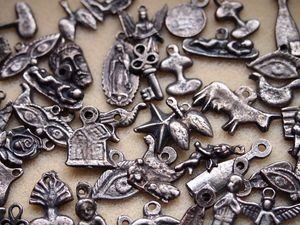Five Antique Silver Milagros