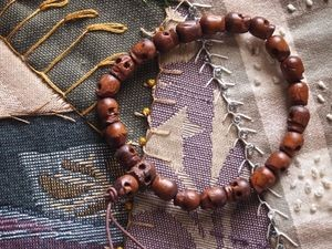 7x8mm wood skull bead mala bracelet