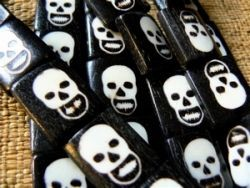 Bone skull tablet beads ivory on ebony