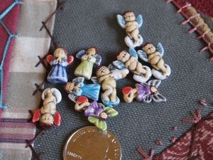 Ceramic:  Angel beads (5)
