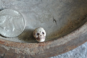 Teenie Tiny High fired porcelain ceramic skull bead