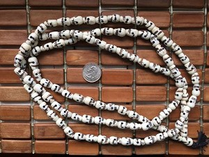 108 carved 8x14mm white bone skull bead mala