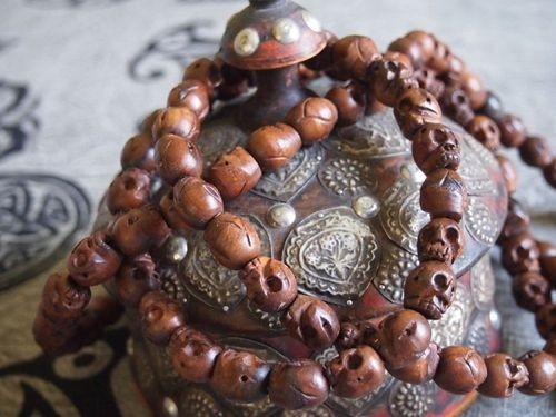 108 bead wood skull bead mala 14x15mm