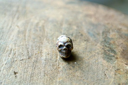 Teenie Tiny High fired porcelain ceramic skull bead-vertical hole