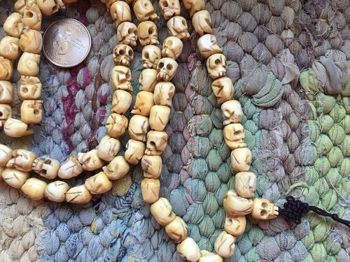 108 carved bone mala 8-9 x 10-11mm skull beads