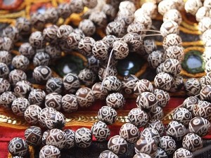 Carved dark bone 7x9mm Rondelle beads-strand with evil eye motif